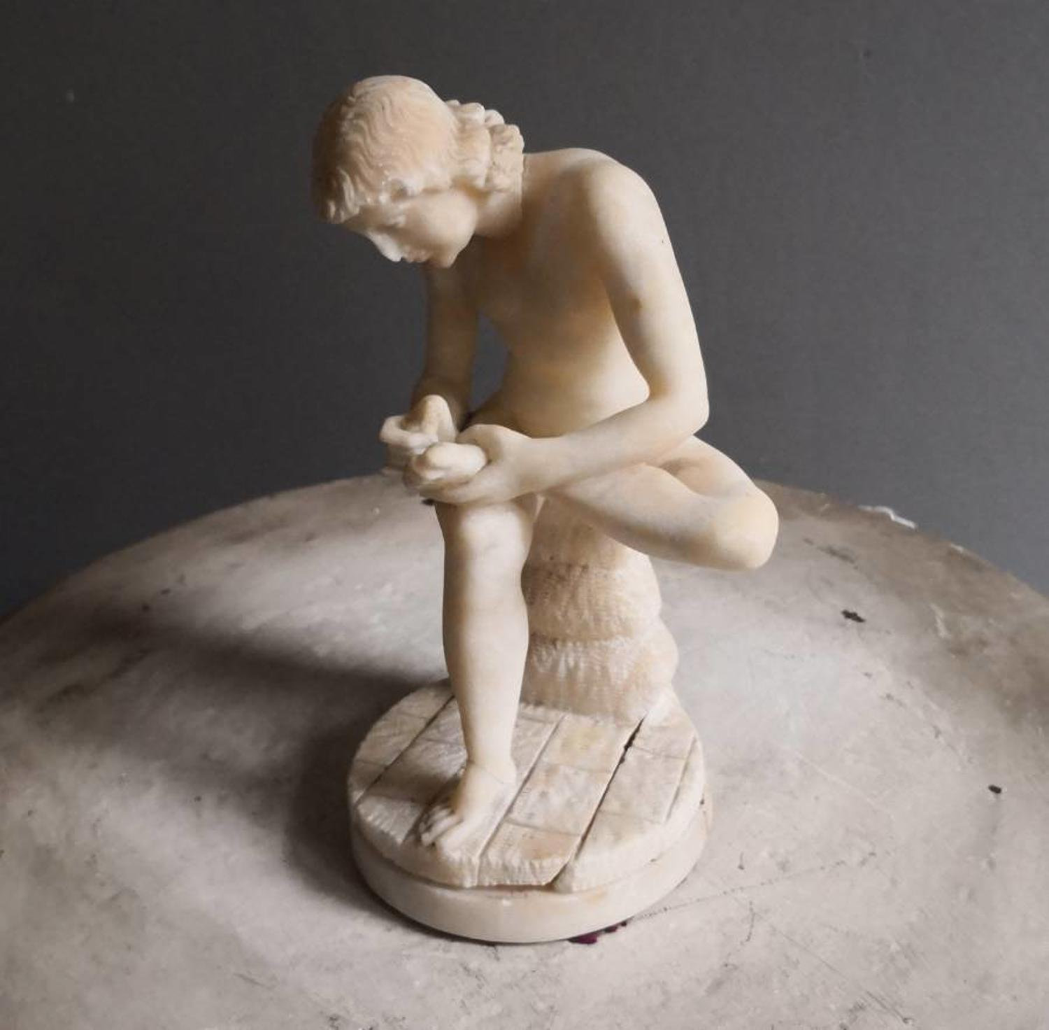 Small alabaster Spinario