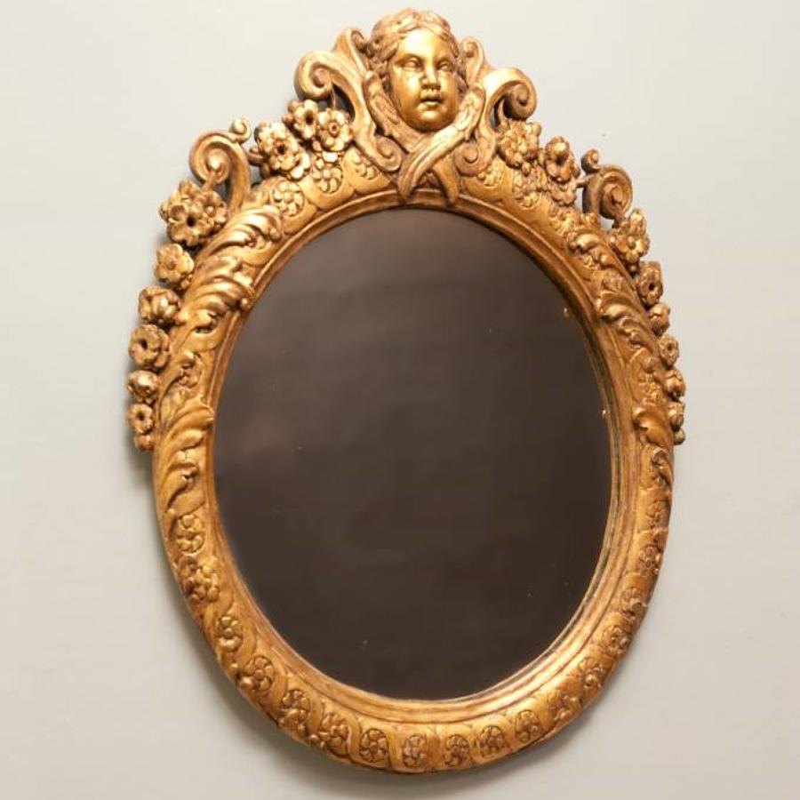 Louis XIV style carved gilt wood mirror