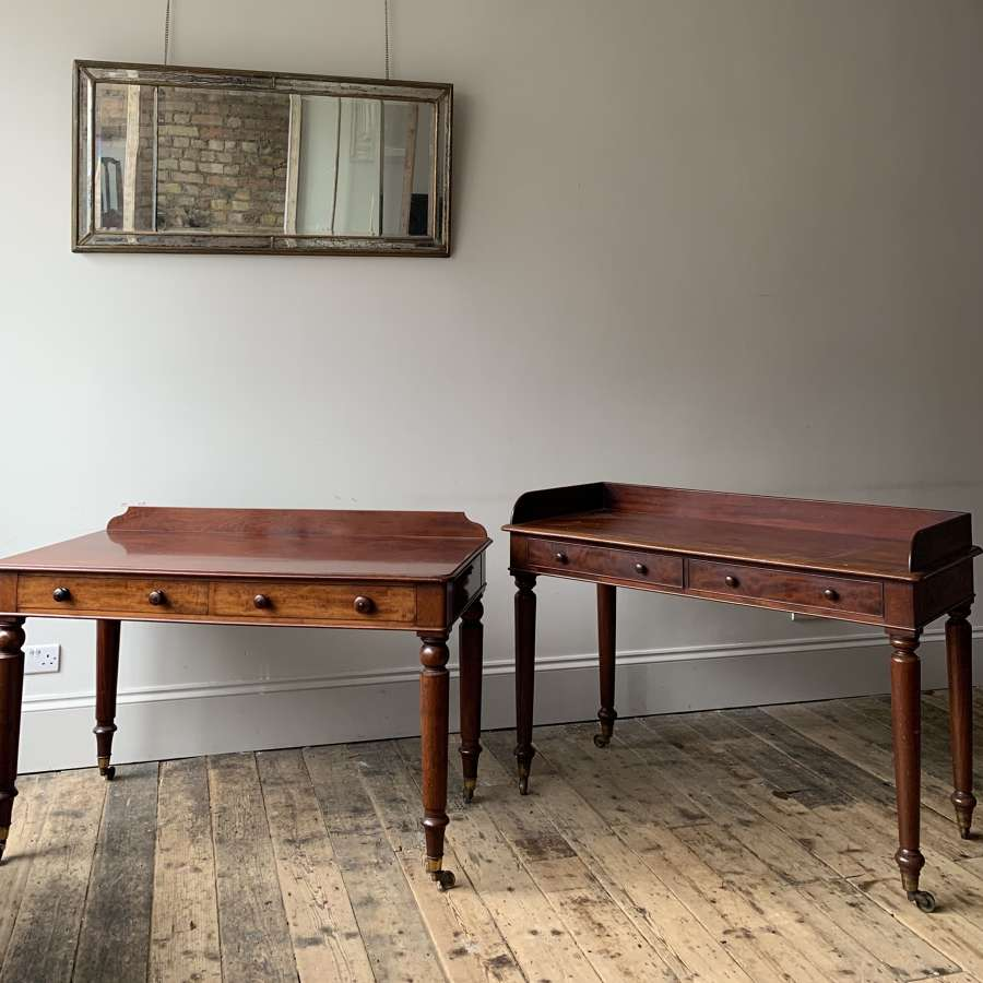 A matched pair of Holland and Sons tables
