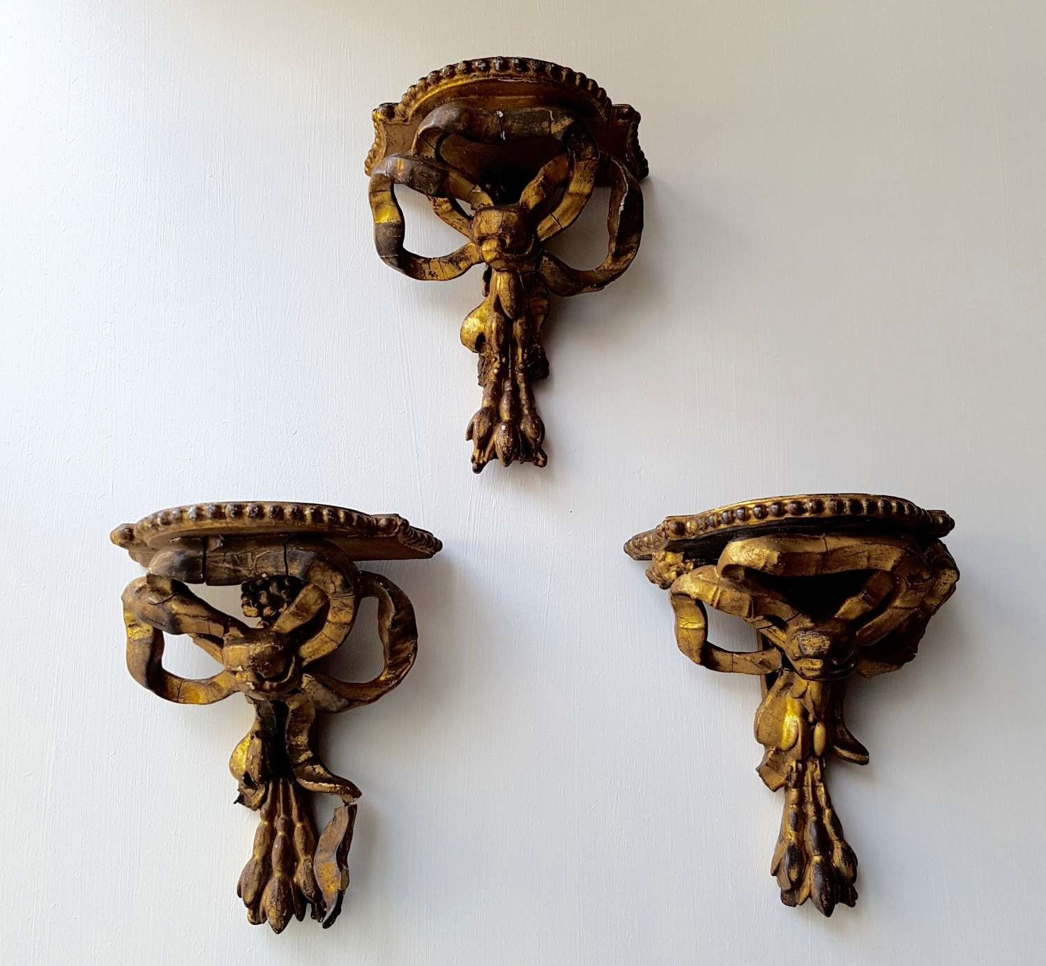 Three gilt wood and composition wall brackets