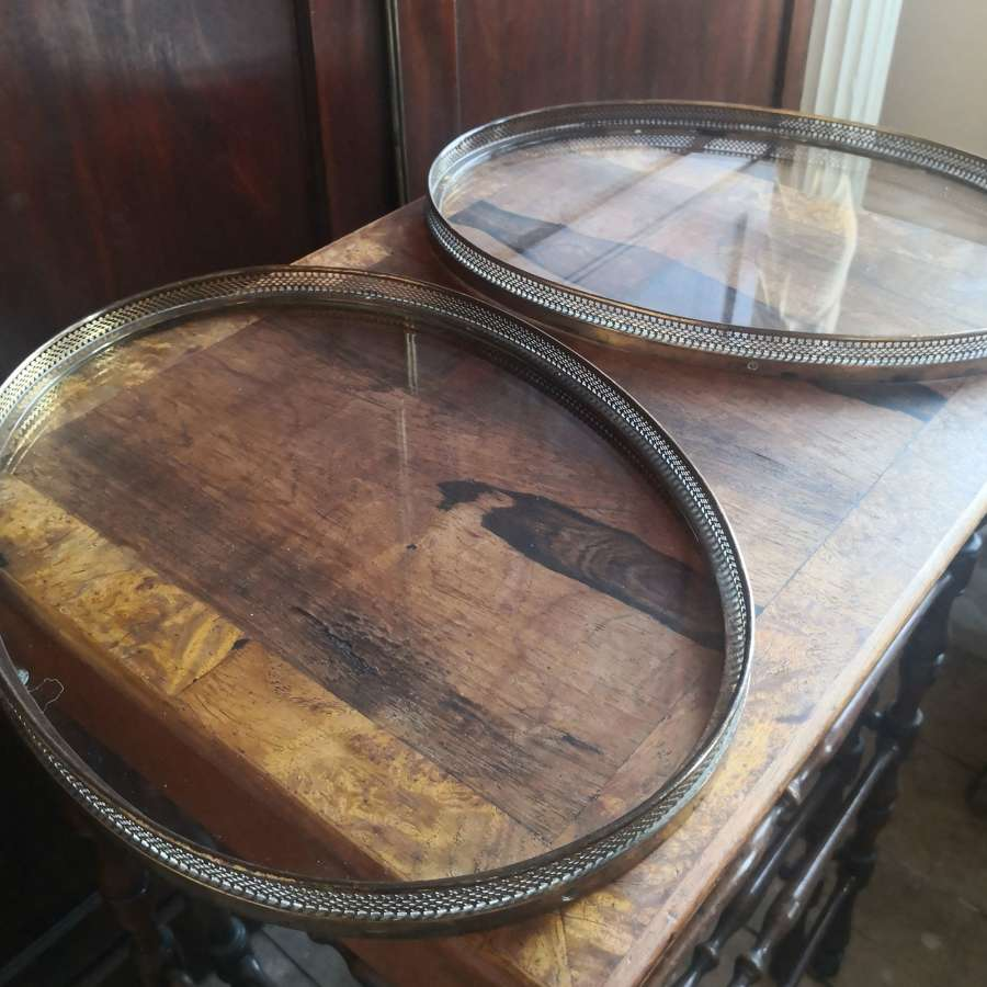 A pair of gilt metal oval trays