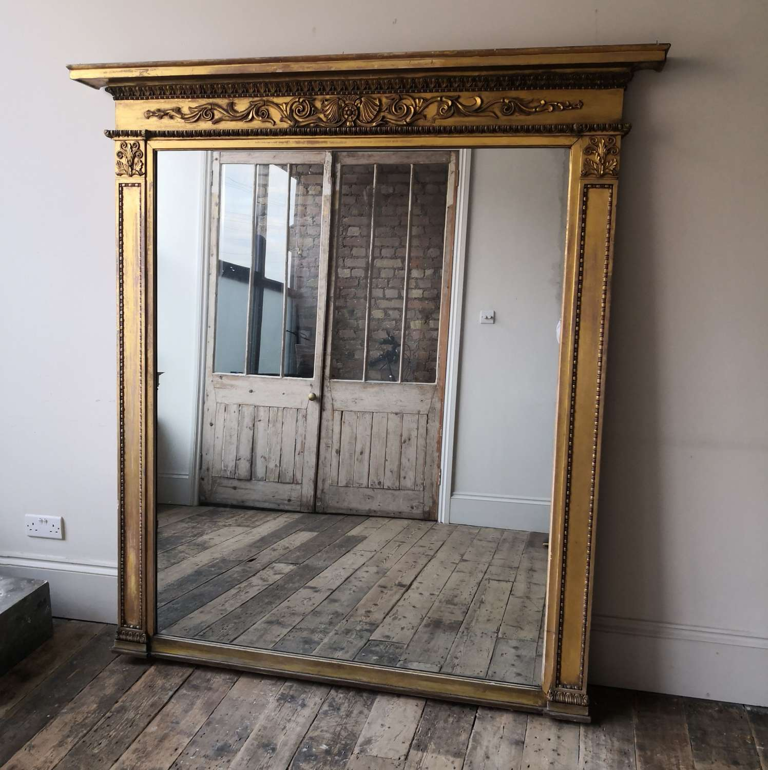 A 19th century gilt over mantle mirror