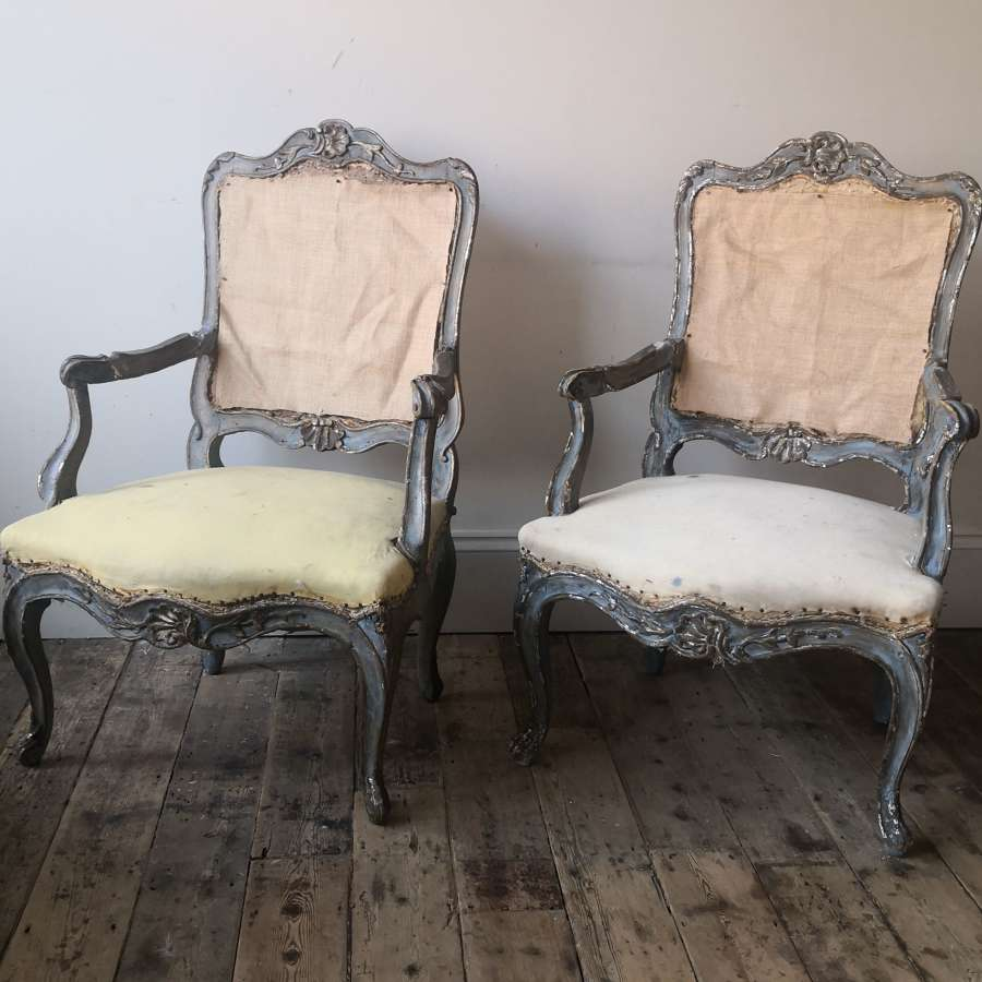 A pair of painted 19th century armchairs