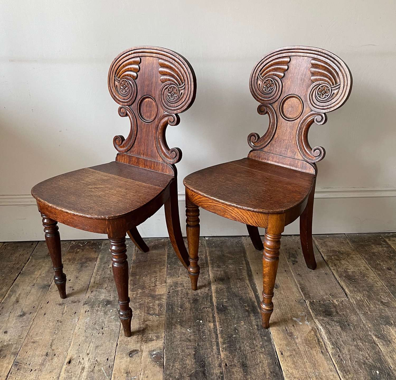 A pair of William IV hall chairs