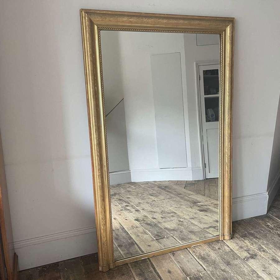 Gilt wood over mantle or floor dressing mirror